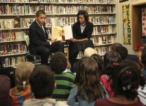 Obama and his wife reading to childtren